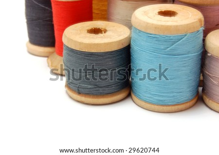 Old Thread reels of different colors isolated on white background - stock photo