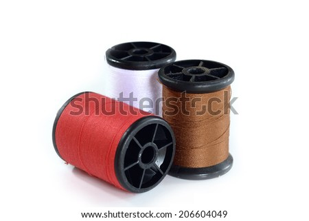 old thread spool isolated on white - stock photo