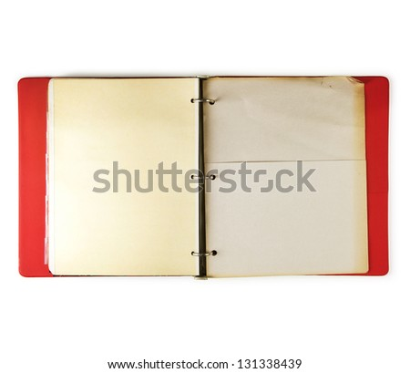 Old three ring red binder open, with old paper pocket page, isolated on white. - stock photo