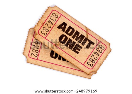 Old ticket : Two vintage torn admit one movie tickets isolated on white.   - stock photo