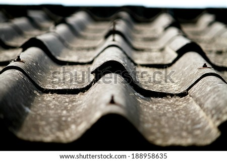 Old tile roof texture - stock photo