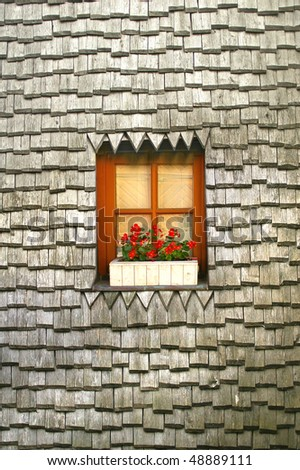 Old tile roof with vintage window - stock photo