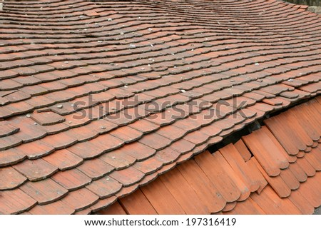 Old tiled roof - stock photo