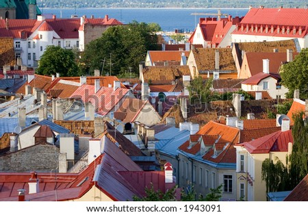 old tiled roofs in tallinn, estonia - stock photo