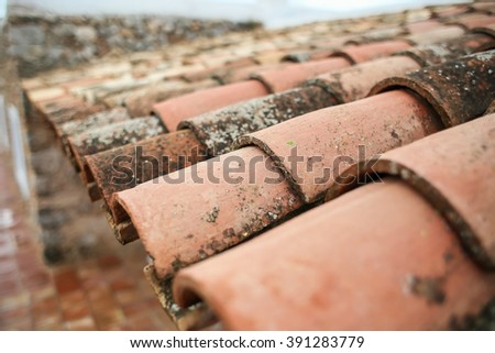 old tiles on the roof of the house - stock photo