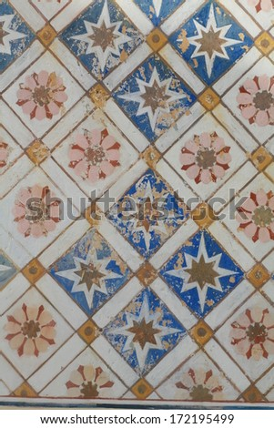 old tiles with ornament - stock photo