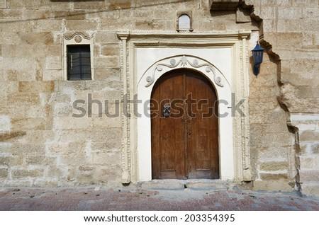 Old timber door Goreme. Cappadocia - stock photo