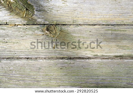 Old timber wall. Old natural wall built from logs laid horizontal. - stock photo