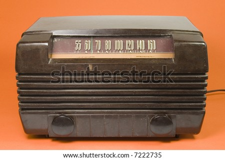 old time bakerlite radio on orange background