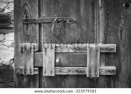 Old time door slide latch with metal lock.  - stock photo