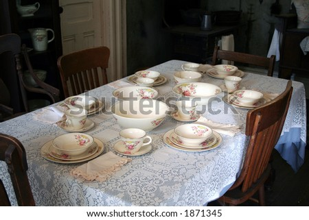 old time family dinner setting - stock photo