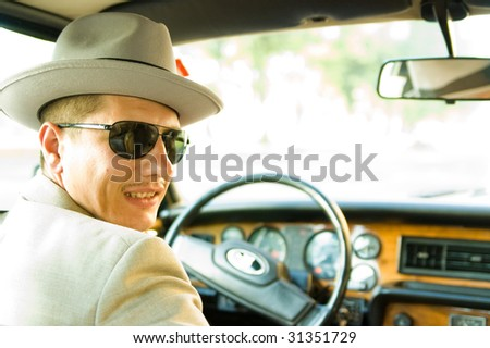 Old-time taxi driver - stock photo