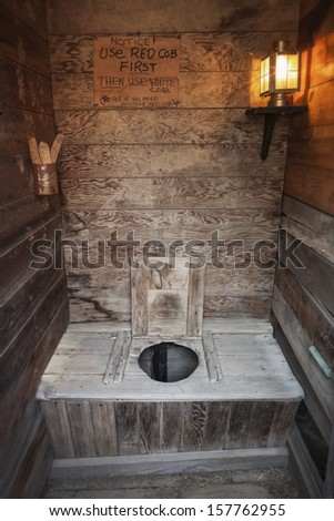 Old Time Wooden Outhouse With Electric Lamp South Dakota