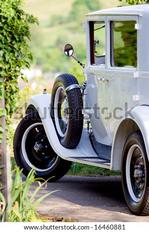 old-timer turning into a road - stock photo