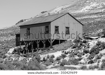 Old tin building in black and white, Bodie, California, USA. - stock photo