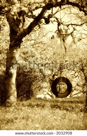 Old Tire Swing Sepia Tone Childhood Memories - stock photo