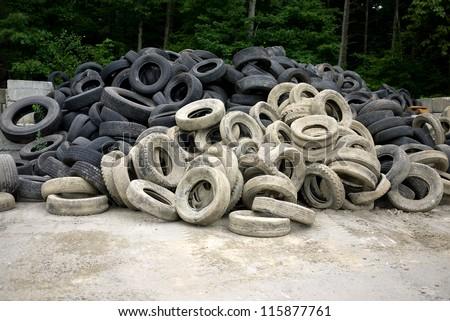 Old Tires at junk yard - stock photo