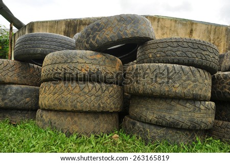 Old tires stacked - stock photo