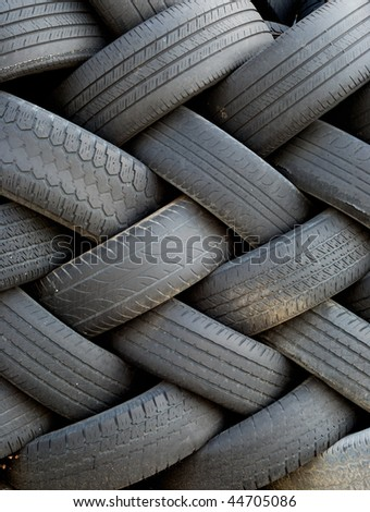 Old tires, stacked artfully, framed vertically - stock photo