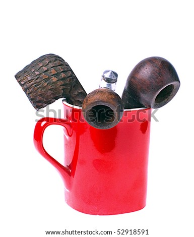 Old Tobacco Smoking Pipes in Red Cup isolated on white - stock photo