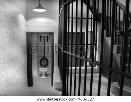 Old toilet in prison cell block dating back to 1854 in monochrome - stock photo