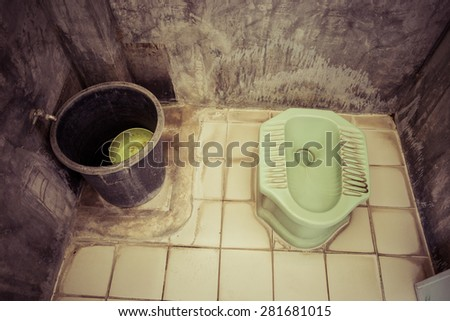 Old toilet in the countryside home. - stock photo