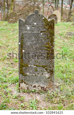 Old tombstone - stock photo