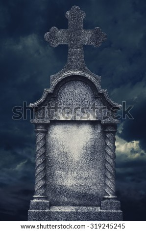 Old tombstone at night. Halloween concept. - stock photo