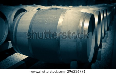 Old toned image of  winery  with  wooden barrels  - stock photo