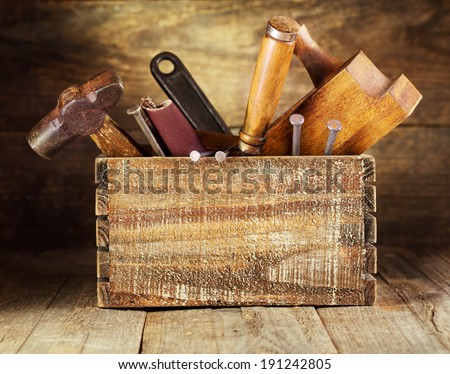 Old tools in a wooden box - stock photo