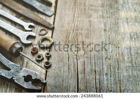 old tools on a dark wood background. tinting. selective focus - stock photo