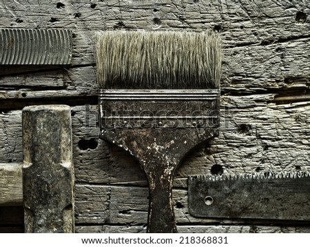 Old tools over grungy wood background - stock photo