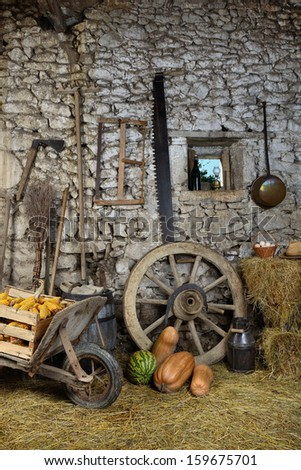 old tools stored in the barn - stock photo
