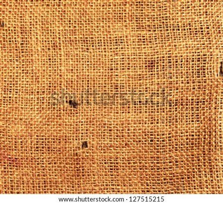 Old torn flaxen sackcloth as natural background - stock photo