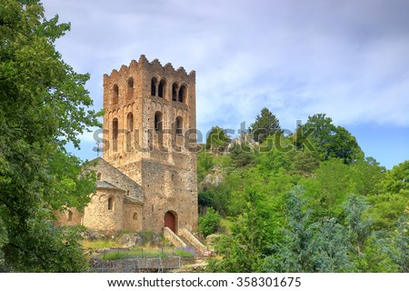 Old tower above medieval church of St Martin du Canigou monastery , Pyrenees-Orientales department, France - stock photo