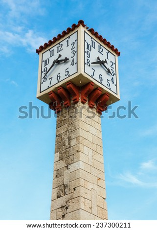 Old tower clock in Piraeus, Greece with blue sky as a background - stock photo