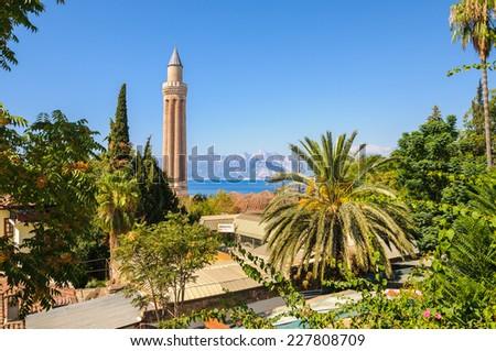 Old town ancient roman harbor, famous minaret Turkey - travel background - stock photo