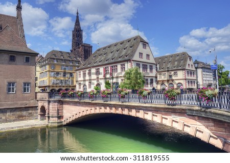 Old town and Cathedral of Our Lady (Notre Dame) of Strasbourg in Alsace. The historic center, including the cathedral, of Strasbourg is UNESCO World Heritage Site, France - stock photo