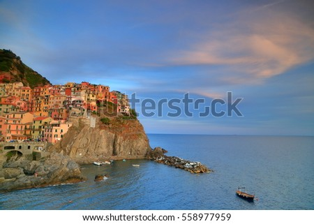 Old town and harbor of Manarola at sunset, Cinque Terre, Italy