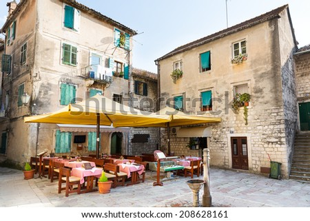 Old town cafe in street - stock photo