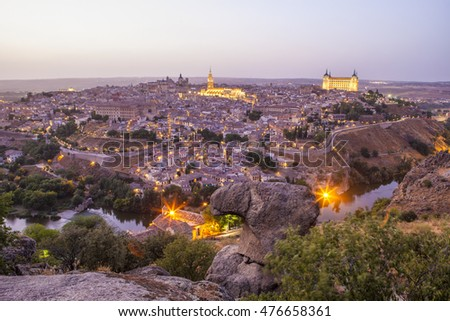 Old town cityscape with Alcazar and river Tagus at twilight, Toledo, Spain