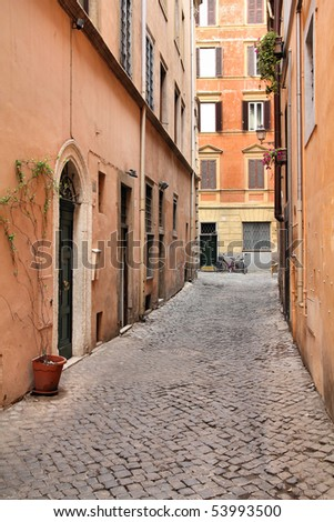 Old town cobbled street and Mediterranean architecture in Parione district of Rome, Italy - stock photo