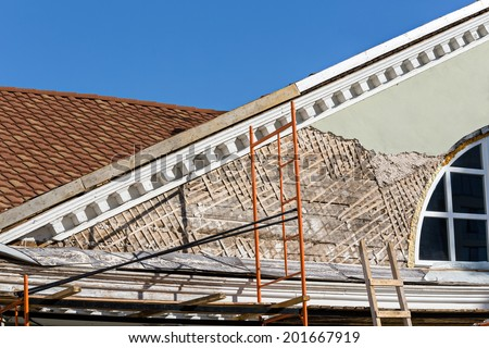 Old town house is being renovated and refurbished - stock photo