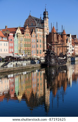 Old Town houses waterfront architecture with reflections on Motlawa river waters in the city of Gdansk (Danzig), Poland - stock photo