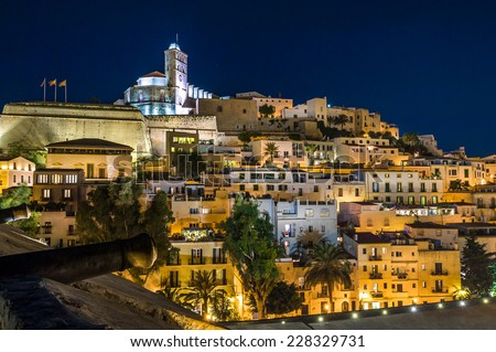 Old town Ibiza on the hill. Houses, fortress and cathedral night scene. Eivissa island, Spain. - stock photo