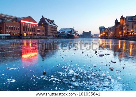 Old town in Gdansk with  Motlawa river at dusk, Poland - stock photo