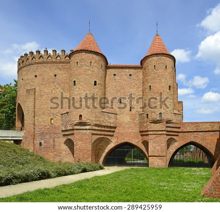 Old town in Warsaw, Poland. Barbican - Fortified medieval outpost in Warsaw. Old town in Warsaw is UNESCO World Heritage Site. - stock photo