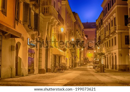 Old Town of Alghero, Sardinia Island, Italy at night. Beautiful city in Mediterranean. - stock photo