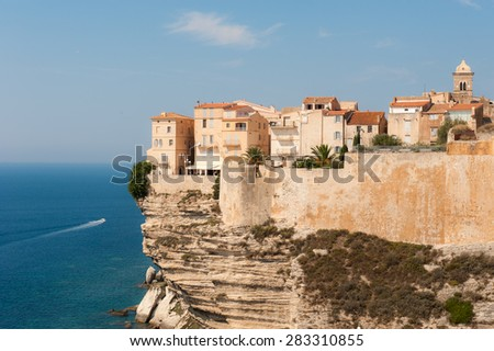Old town of Bonifacio is built high on a sea cliff. Corsica, France - stock photo