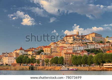 Old town of coimbra glows at sunset under a pretty summer sky, Portugal